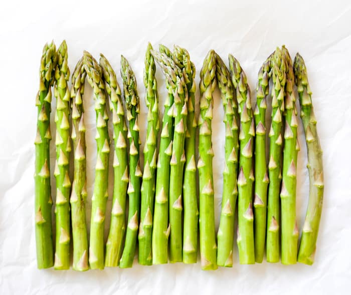 Asparagus Candles :: Add fresh asparagus around a cylinder shaped candle and instant springtime happiness
