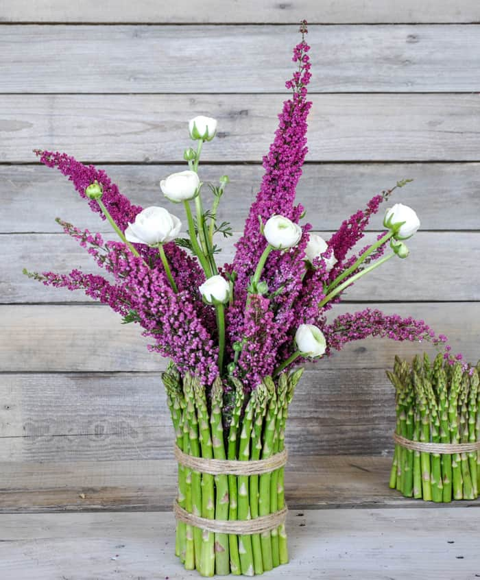 Cover a cylinder vase with fresh asparagus and fill with spring flowers!