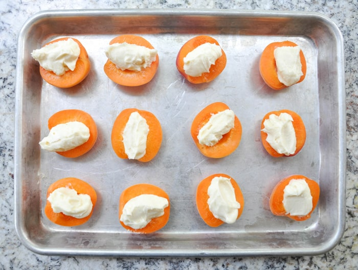 Halved apricots filled with cream.