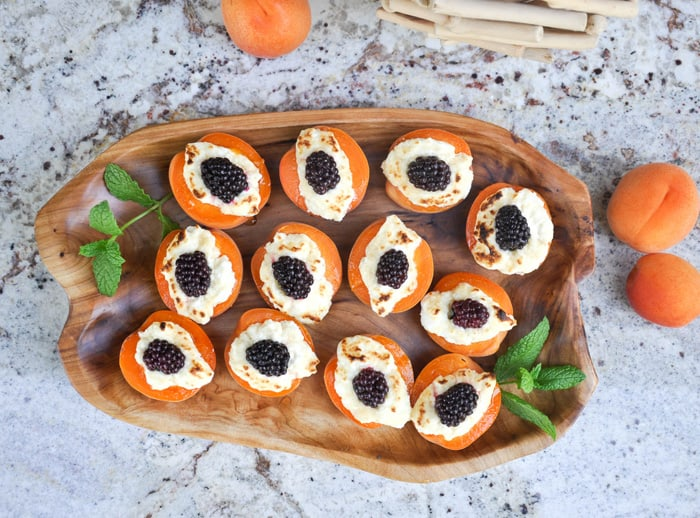 Baked apricot blackberry jewel on serving tray with mint sprigs