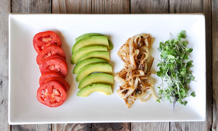Stackable lineup: tomato, avocado, grilled onions and microgreens
