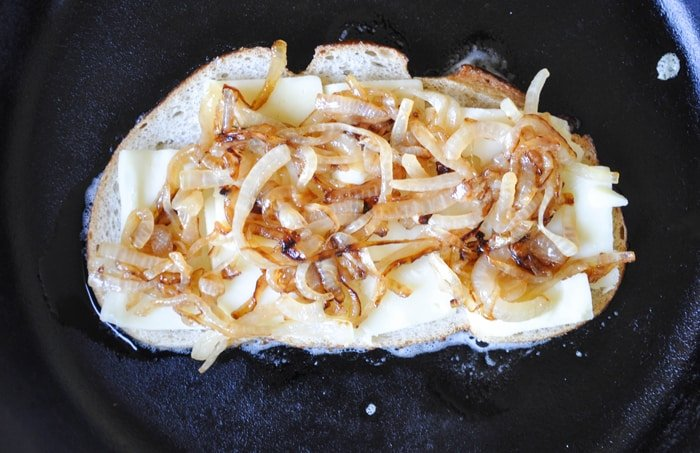 Grilled onions added on top of cheese