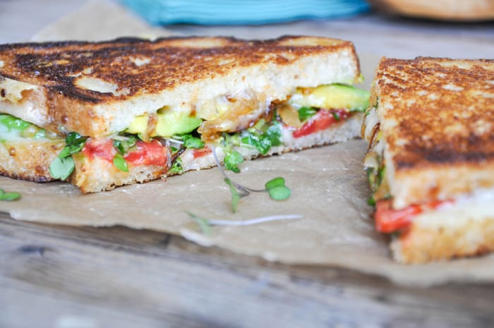 Garden Grilled Cheese - Cheesy comfort with avocado, tomato, grilled onions and microgreens