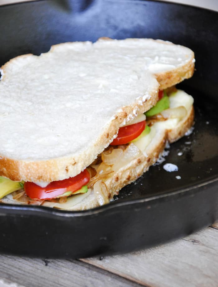 Close the sandwich by adding the other slice of bread, butter side facing out