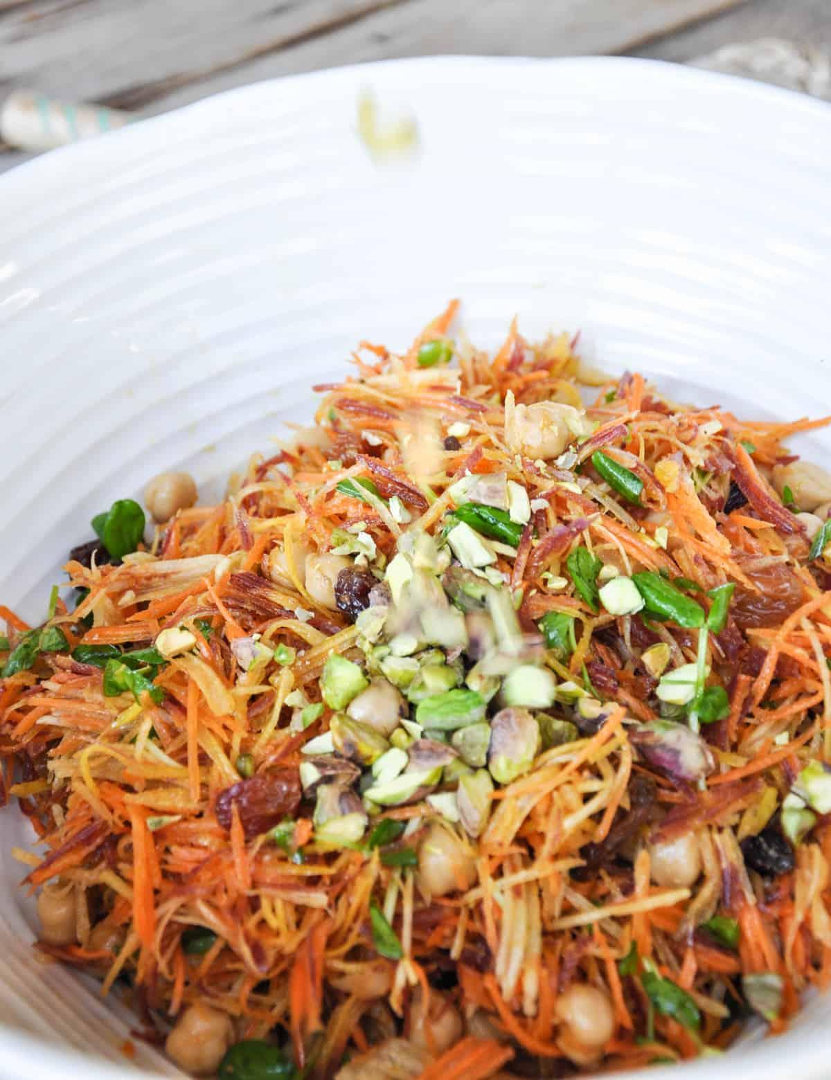 Sunshine Salad using Tri-Color Carrots with garbanzo beans, crimson raisins, pea shoots, feta cheese and pistachios. Holy yum!