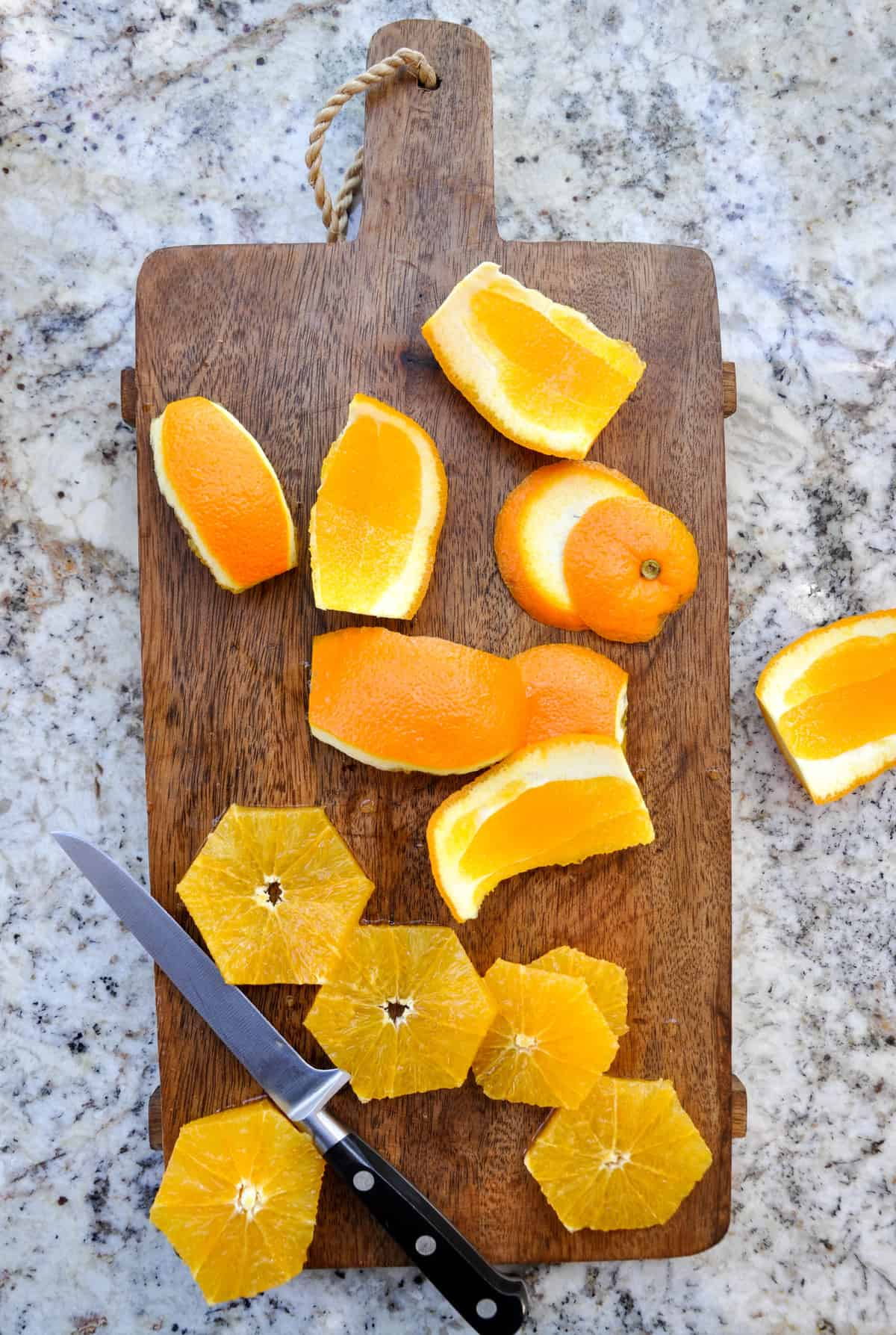 Citrus sliced up on a cutting board