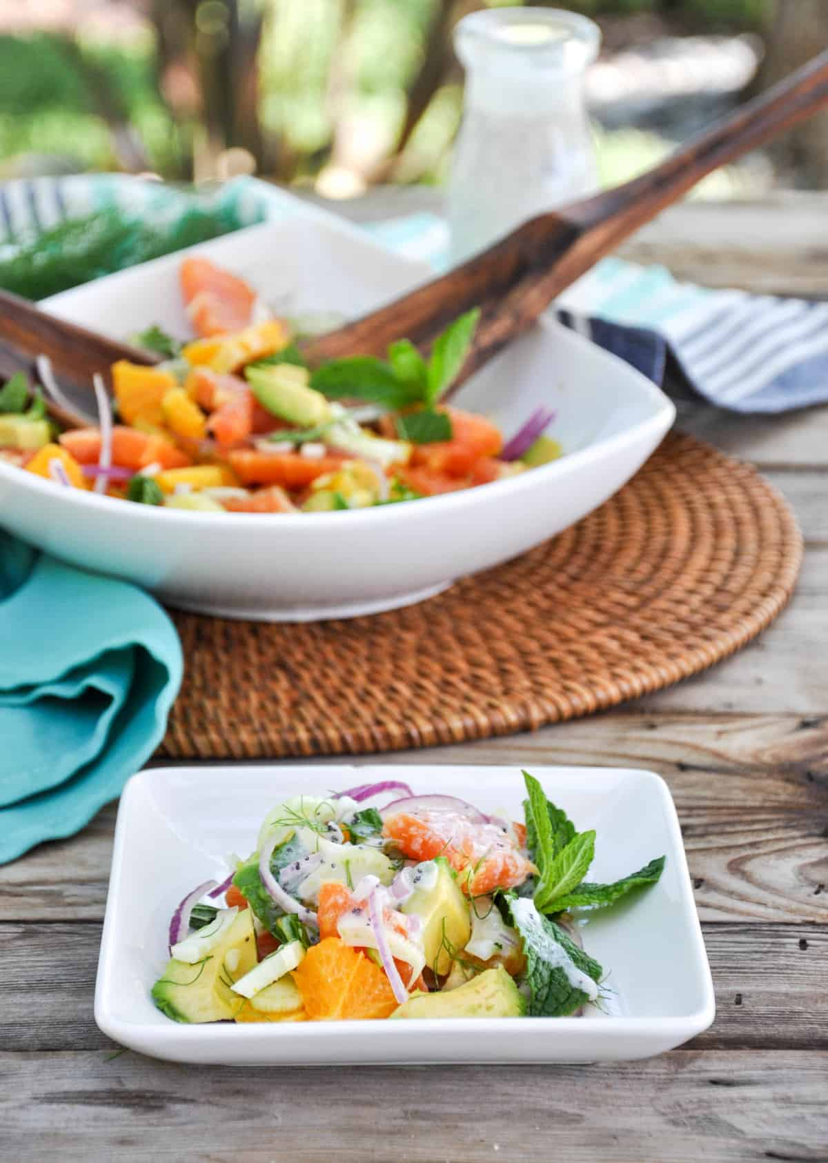 Citrus Spring Salad in serving bowl and on a plate