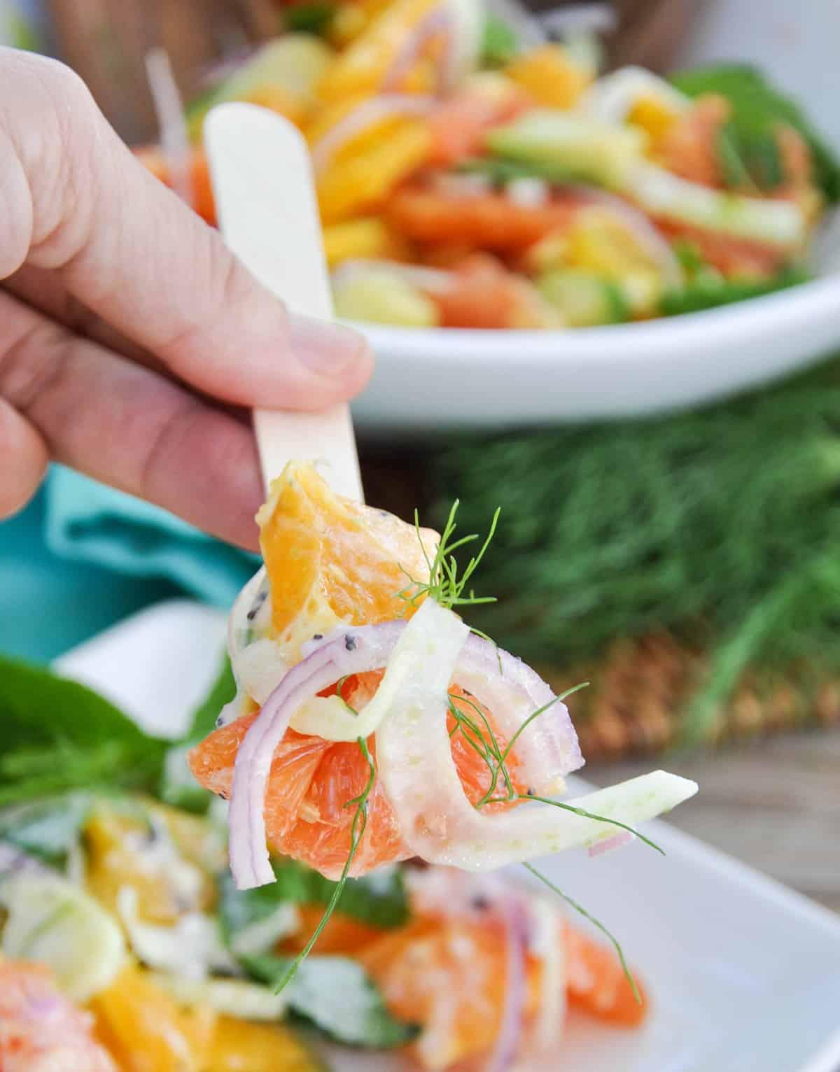 Fork picking up Citrus Spring Salad