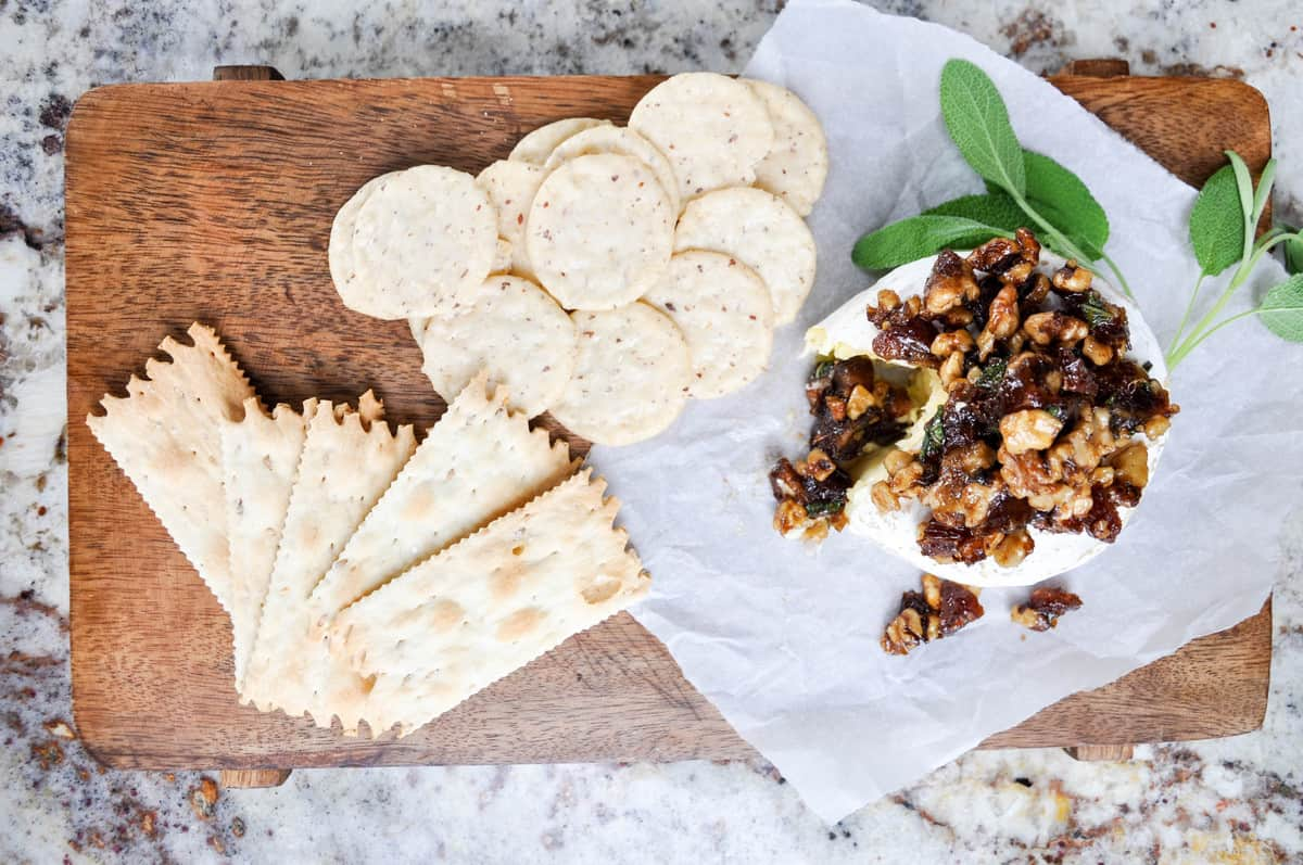Medjool Dates and Walnuts with a bit of Sage, top this obey gooey baked brie. Yum!