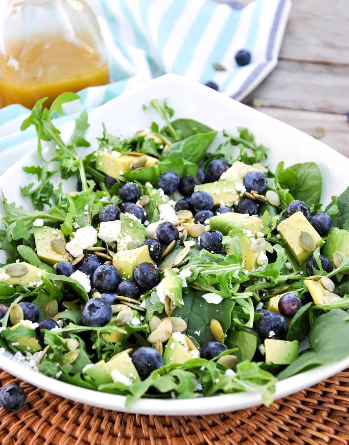 Blueberry Avocado Salad with feta, pumpkin seeds in a honey vinaigrette