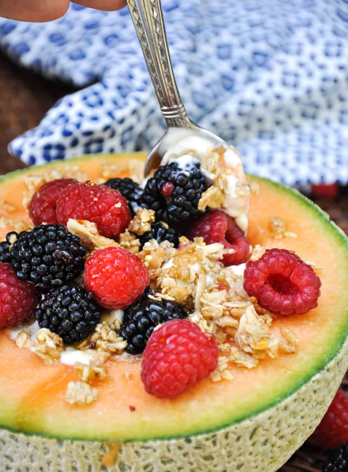 Cantaloupe Breakfast Bowls. Perfect for dessert too! Load the center with greek yogurt and top with fresh berries and granola. YUM!