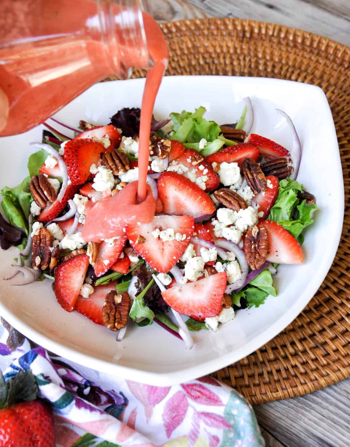 Strawberry Salad! With gorgonzola, pecans ad a bit of red onion. Plus topped with a fabulous strawberry vinaigrette!!