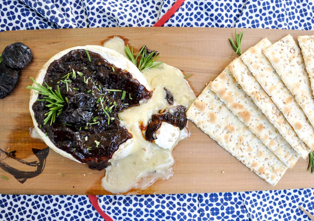 Cedar Planked Brie topped with Dried Plum Rosemary Sauce
