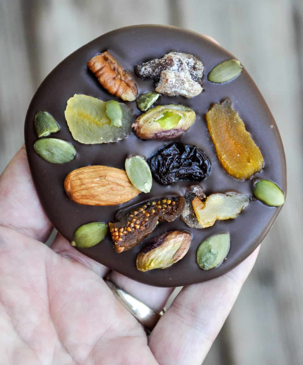 Dried Fruit and Nut Super Snack. Dark chocolate loaded with healthy fruit and nuts to boost your energy all while curbing that chocolate craving