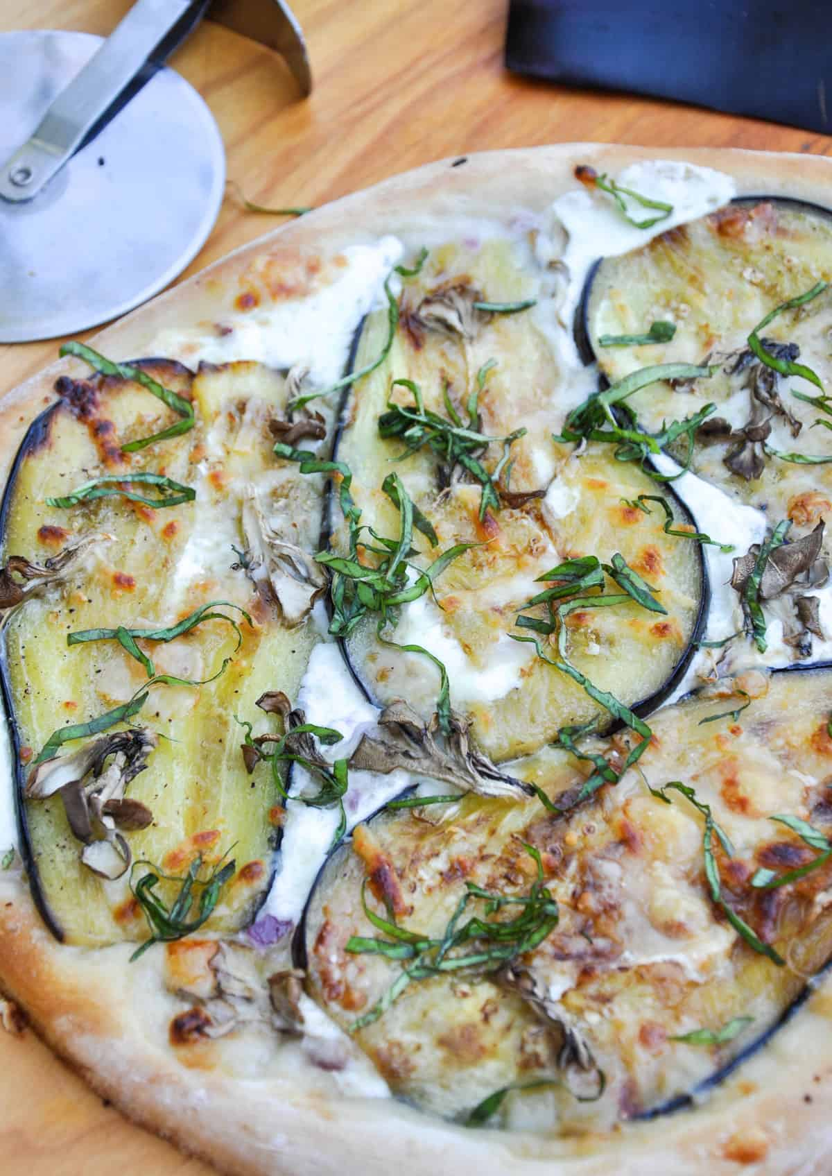 Eggplant Pizza. Earthy and delicious, this pizza incorporates fresh mozz, eggplant and mushrooms for a beautiful presentation and wonderful flavor