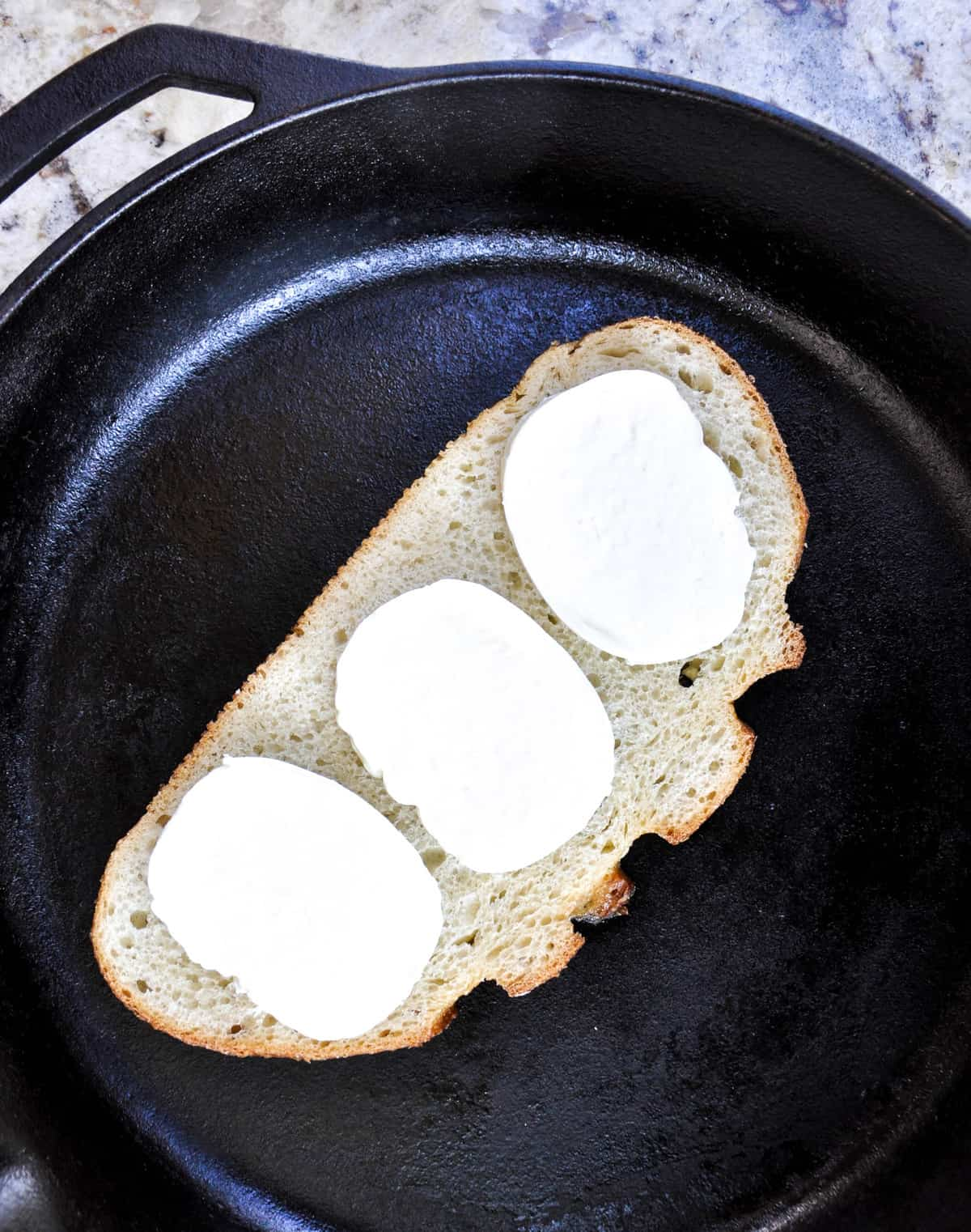 Sourdough bread with mozzarella cheese in skillet