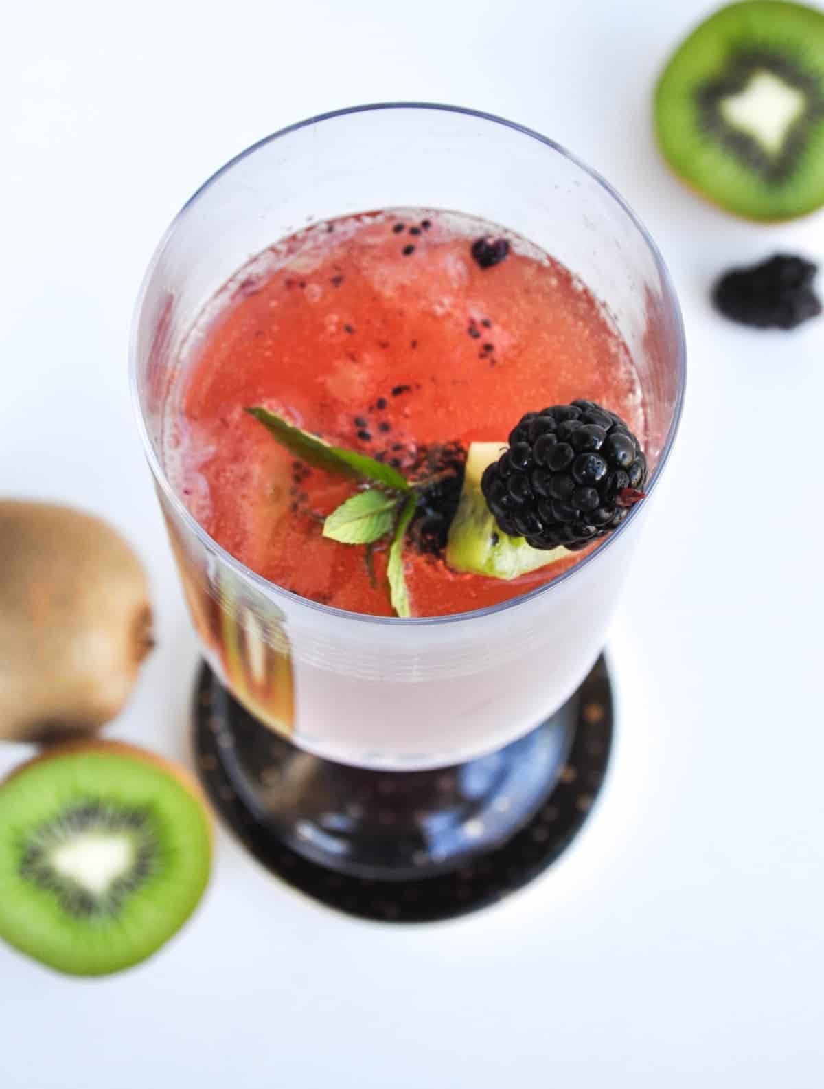 Blackberry Kiwi Mimosa with blackberry, kiwi skewer as garnish