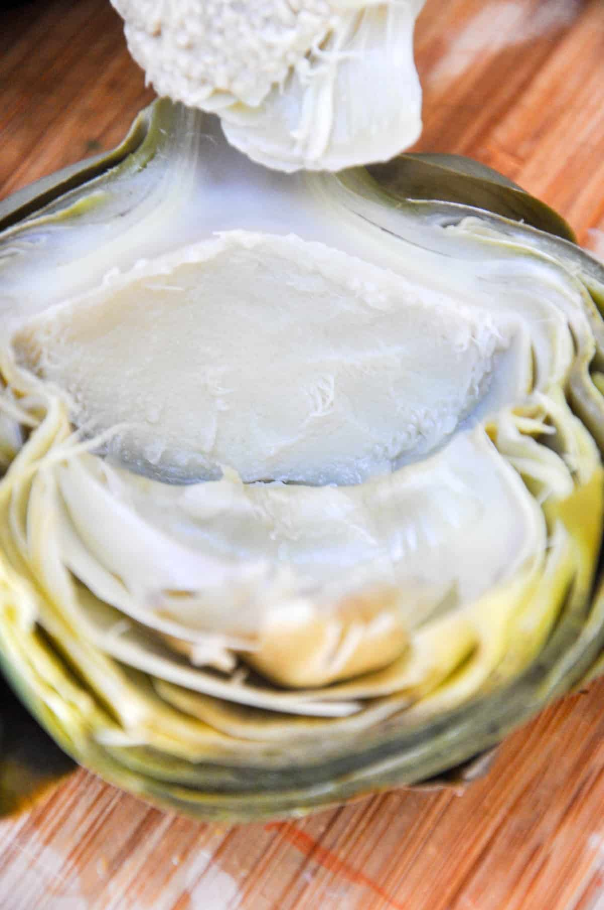 Remove flesh of artichoke with spoon
