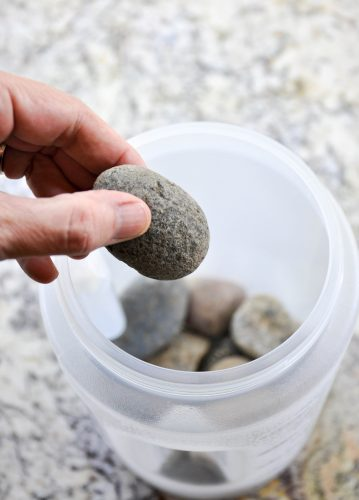 How to make a floral ice bucket - secure the inner mild by placing rocks in the bottom of the smaller bucket.