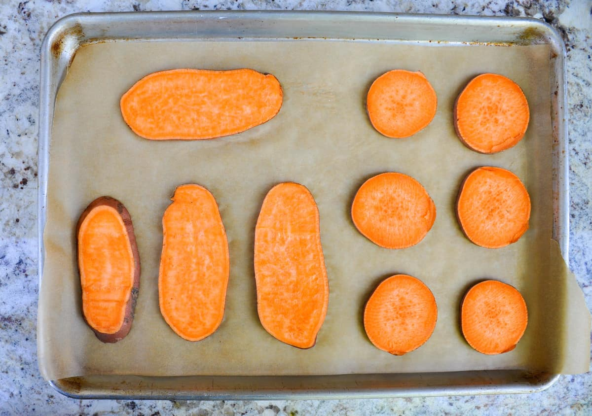 Line sliced sweetpotatoes to baking sweet with parchment paper