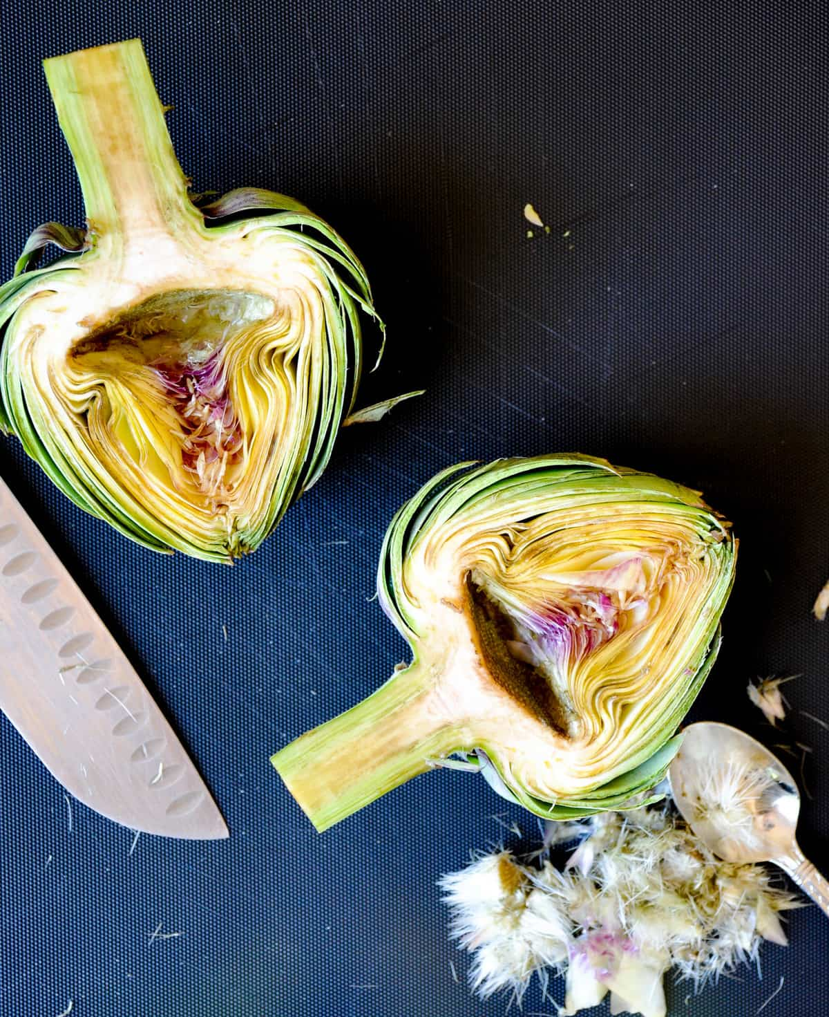 Remove the hairy part of the artichoke