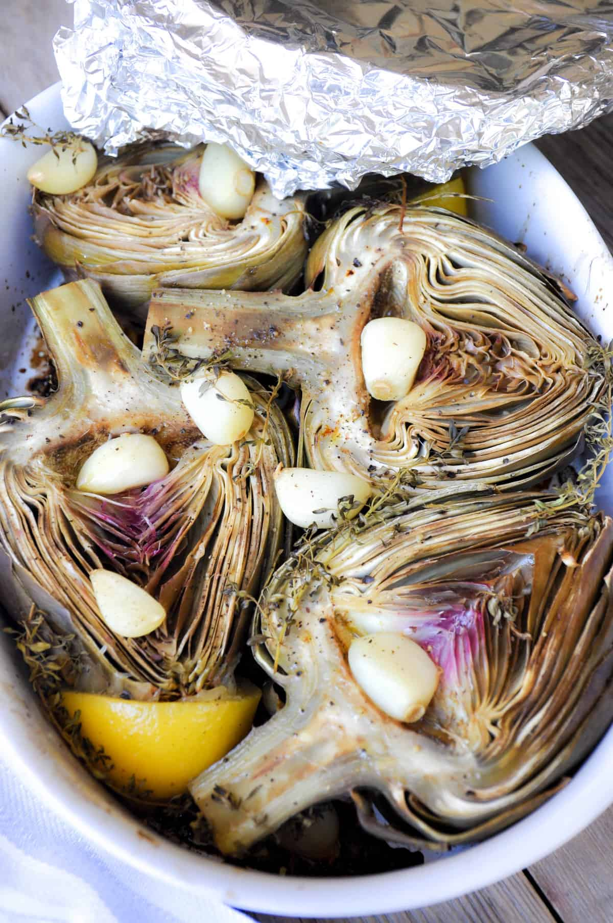 Bake artichokes with foil over dish pan