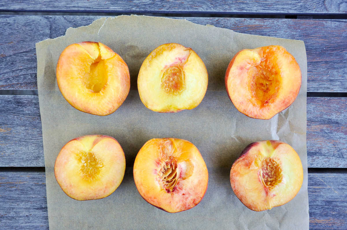 Halved peaches, pitted