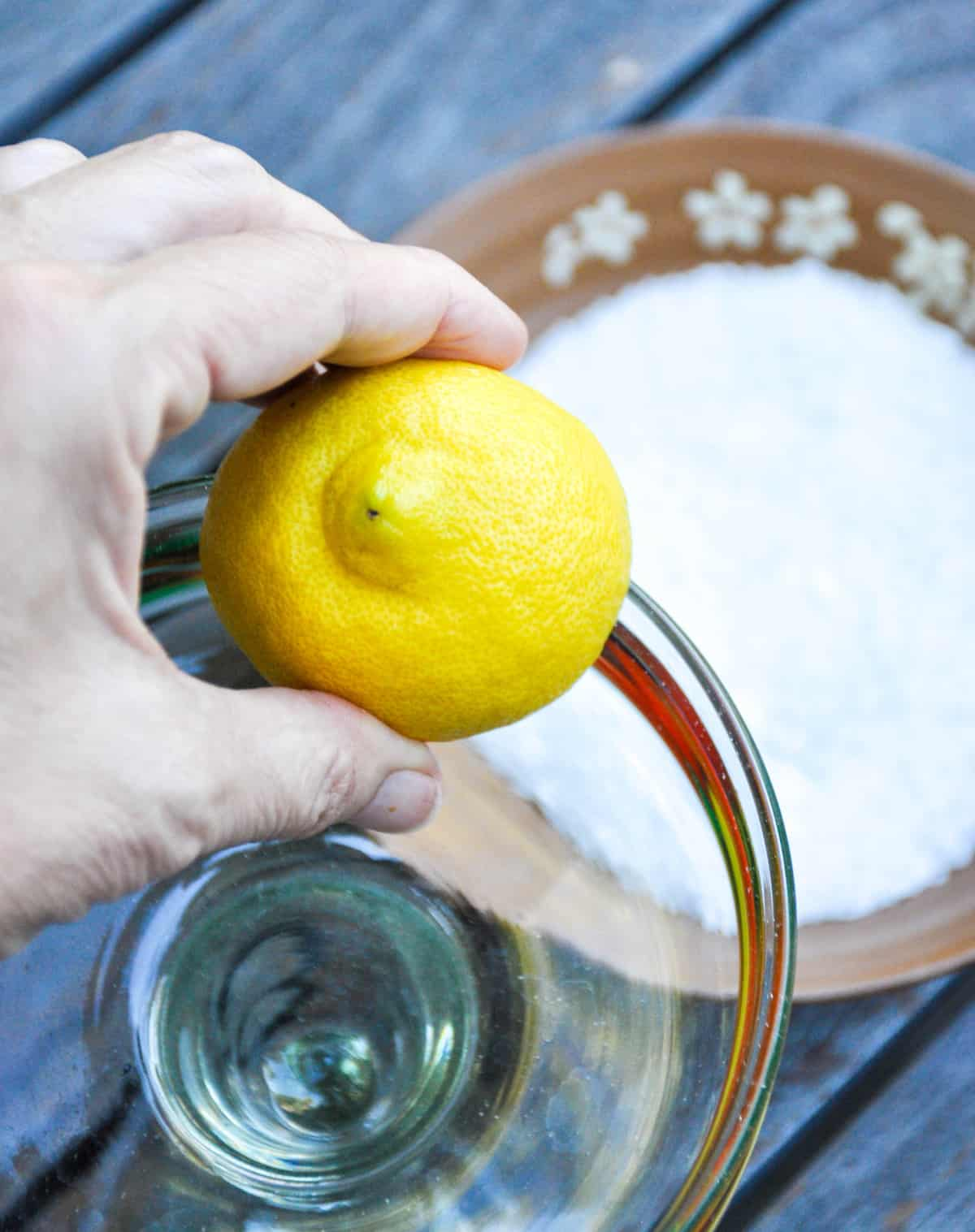 Use lemon to moisten the rim of glass