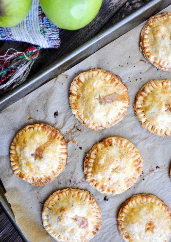 Baked Caramel Apple Hand Pies  on a baking sheet.