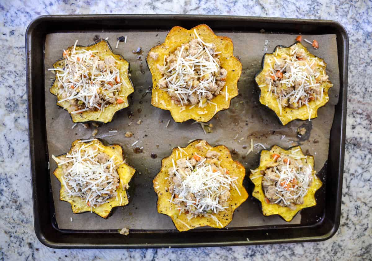 Roasted Acorn Squash stuffed with ground turkey, pears and parmesan! So dang yummy and the epitome of Fall dinner.