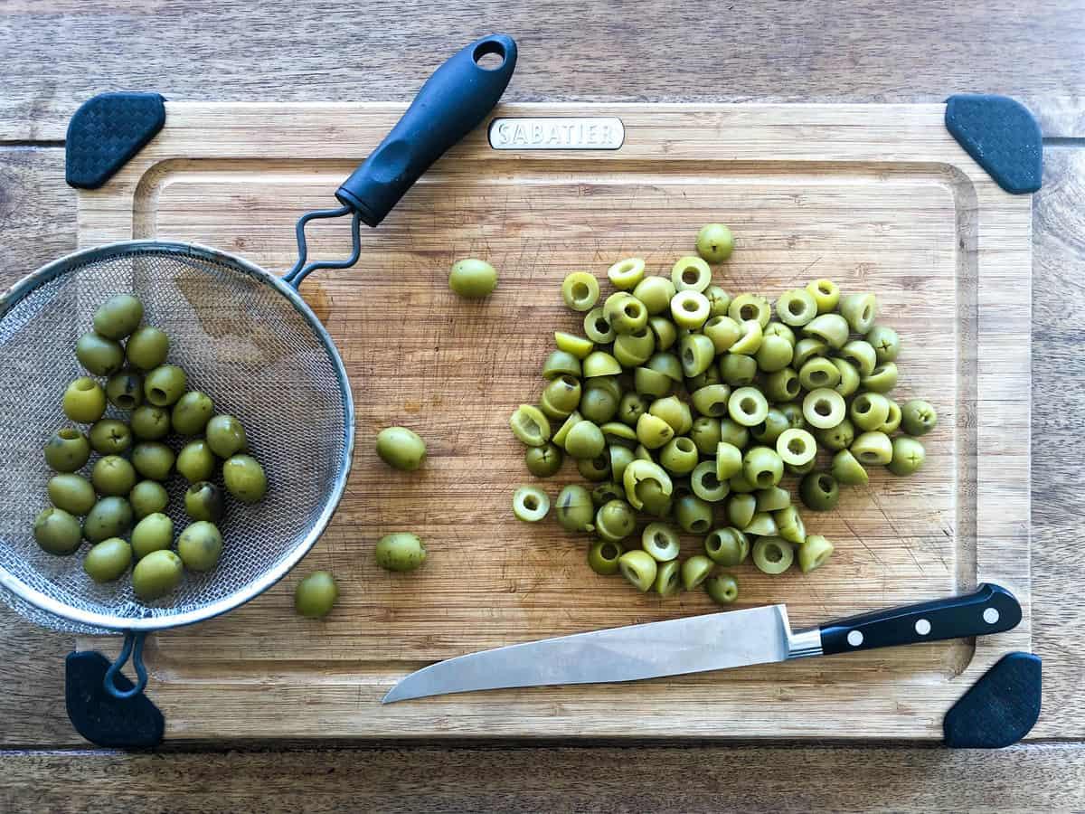 Slice each olive in half.