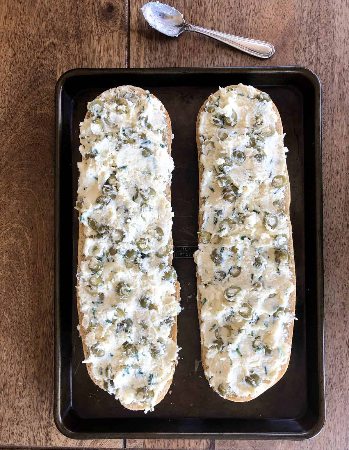 Spread the mixture onto both halves of the bread and bake in a 350-degree oven for 20 minutes.