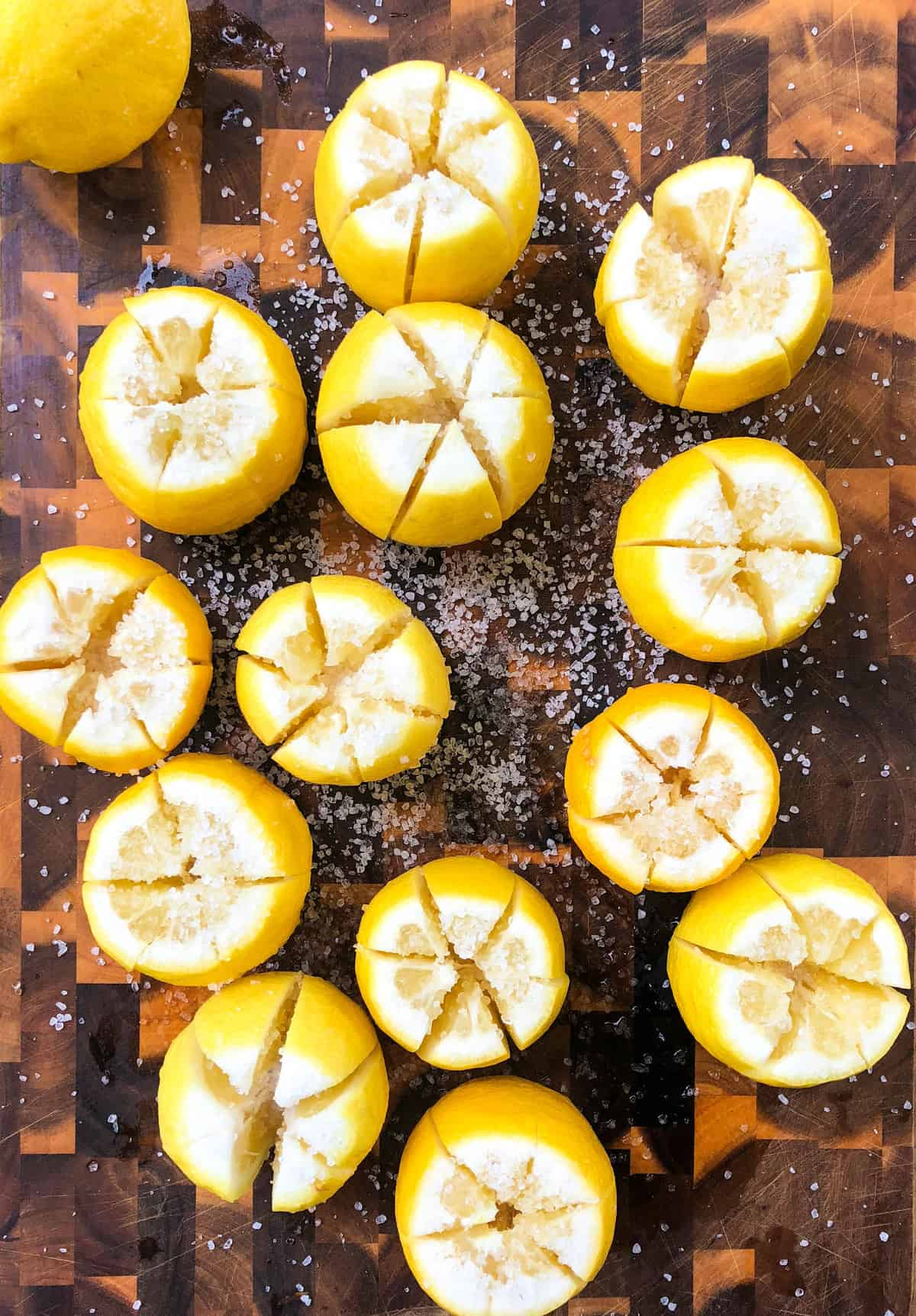 Add coarse salt to the lemons.