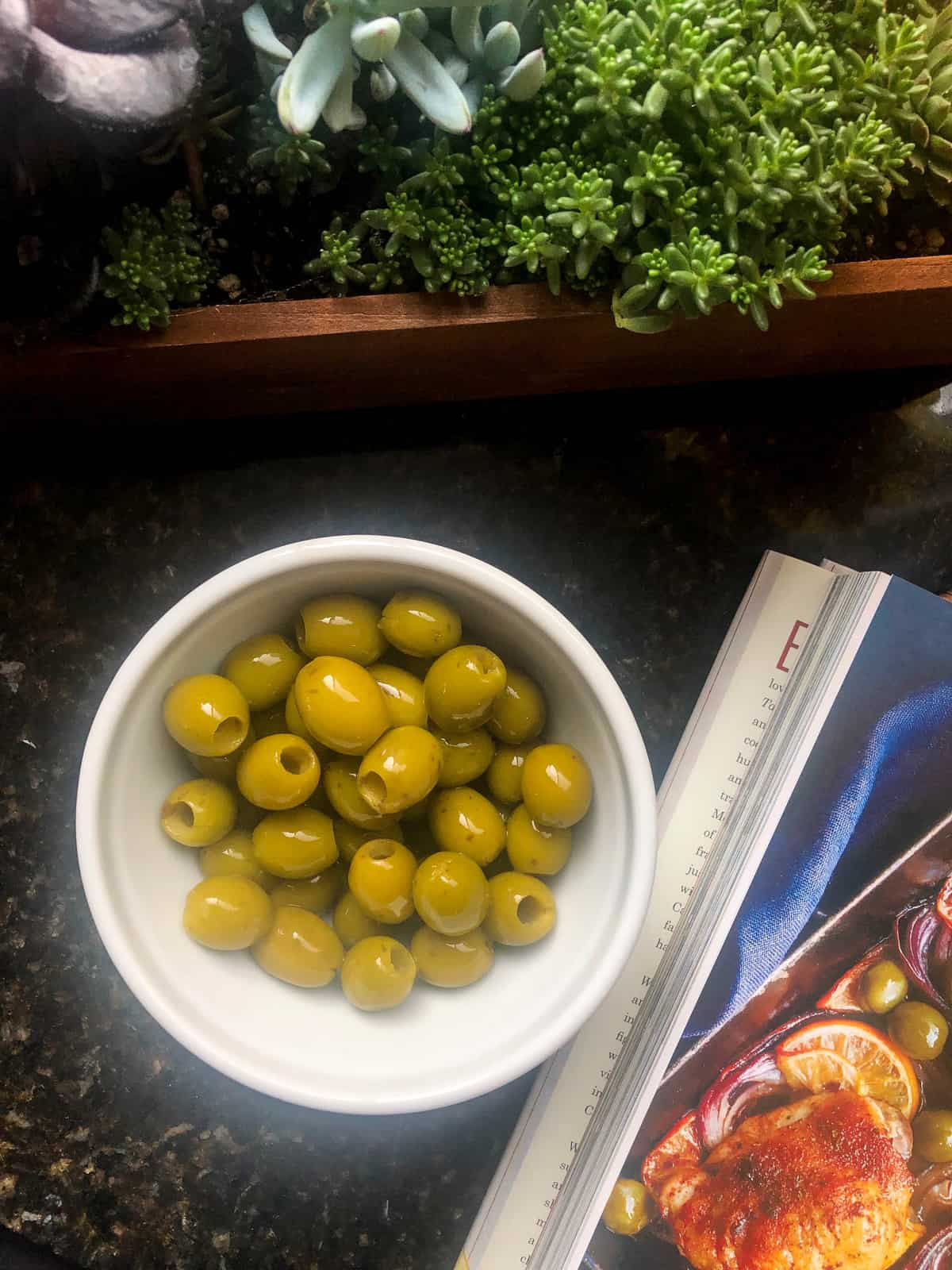 Pour in a drained can of California green olives and roast for another 5-10 minutes.