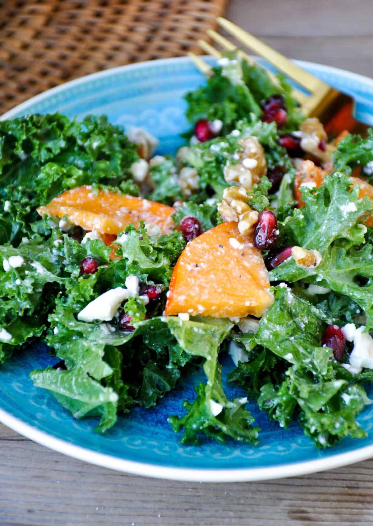 Kale Salad with persimmons, pomegranates and leafy greens