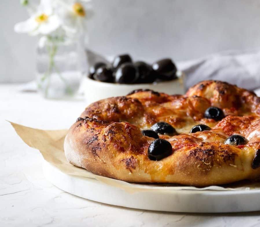 Beer Crust pizza recipe using marinated california ripe olives