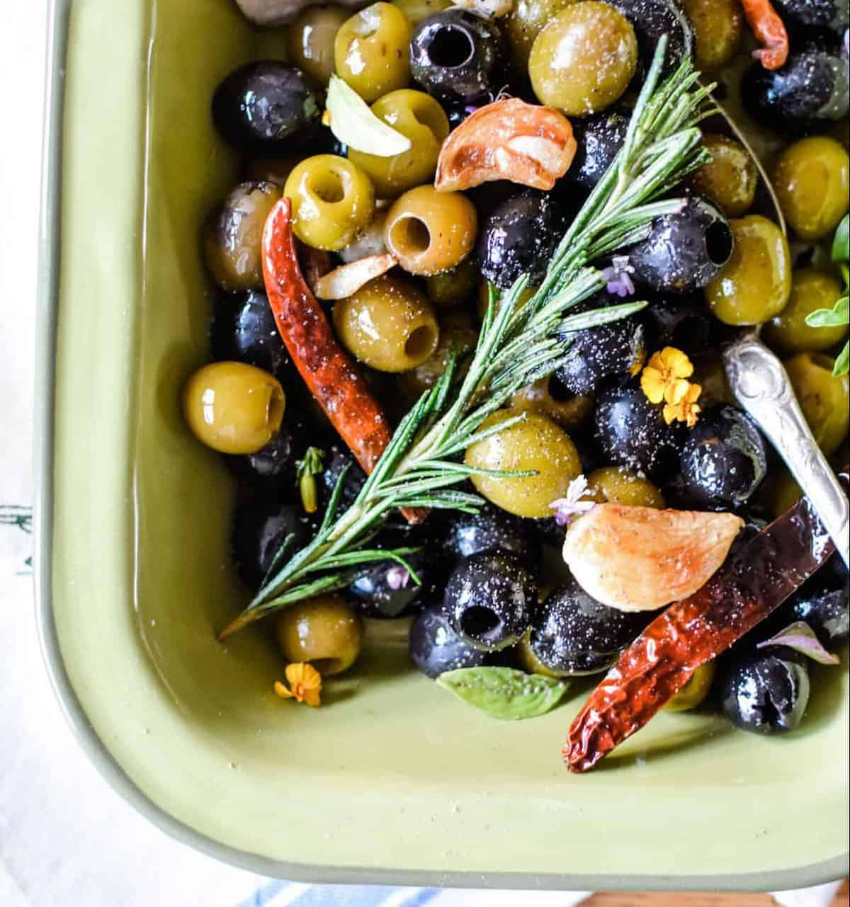 Spicy marinated olives with garlic and herbs