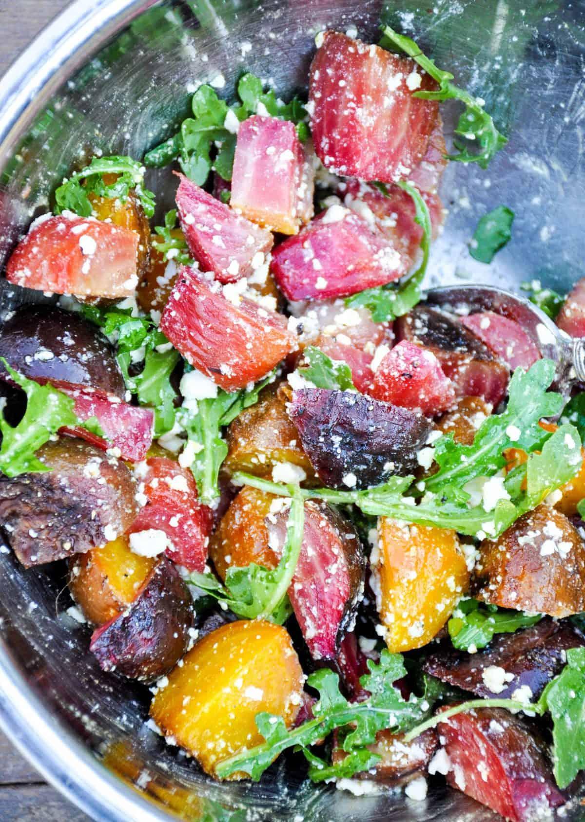 tossing beet salad