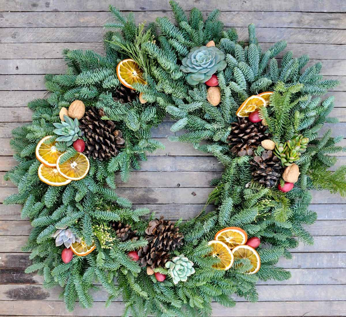 Fresh Wreath with Dried Citrus, Whole Nuts and Succulents