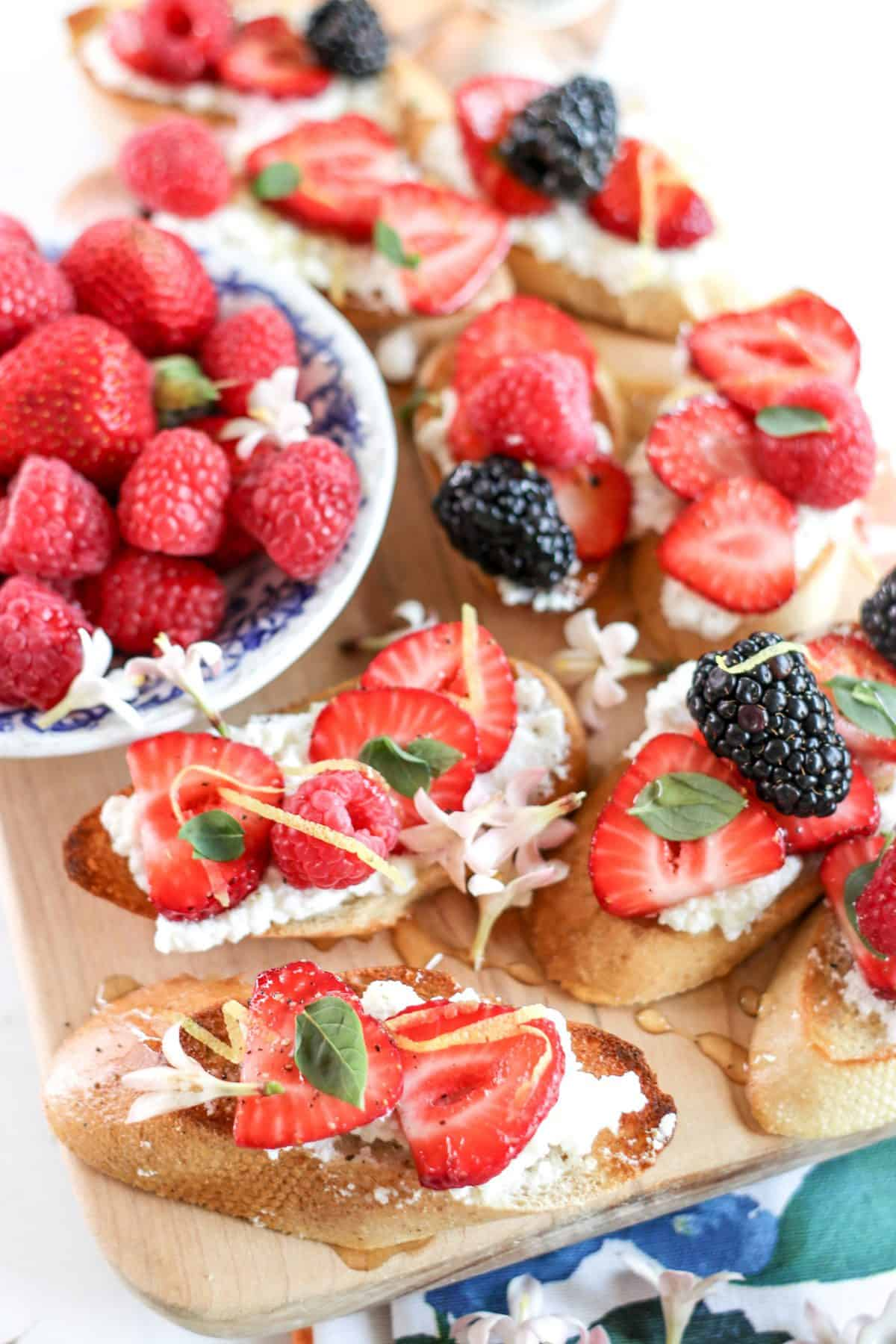 berry crostini with strawberries, blueberries and blackberries
