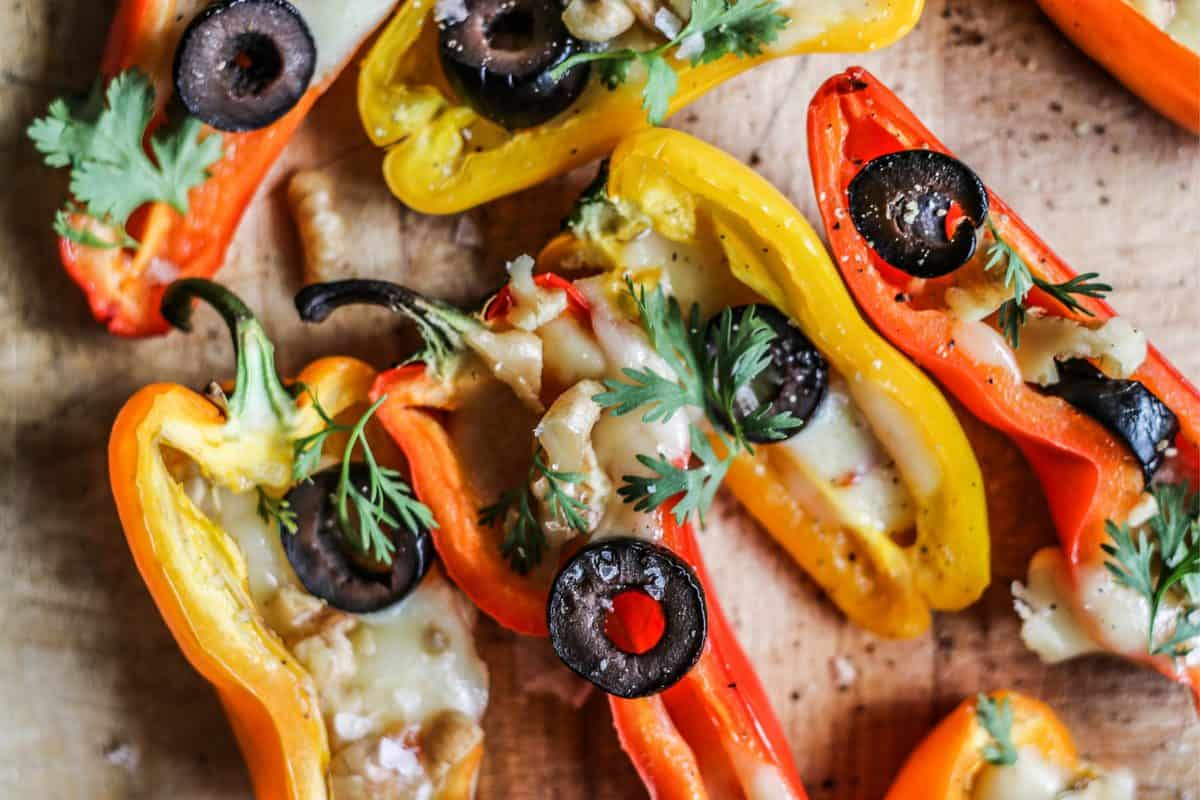 Mini Stuffed Peppers Recipe with Olives and Pepper Jack Cheese close up of colorful stuffed peppers