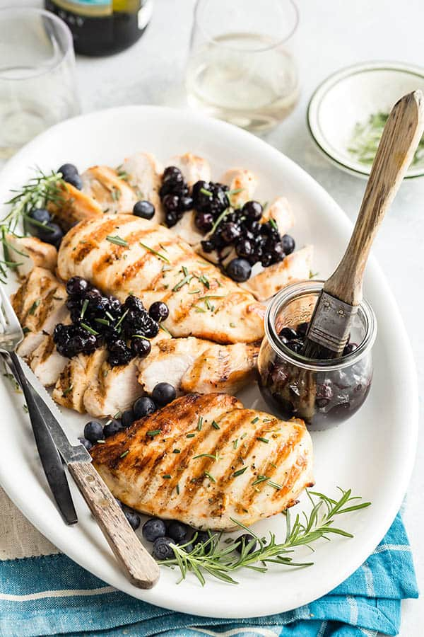Grilled Chicken breasts with Blueberry Relish spooned over the top.