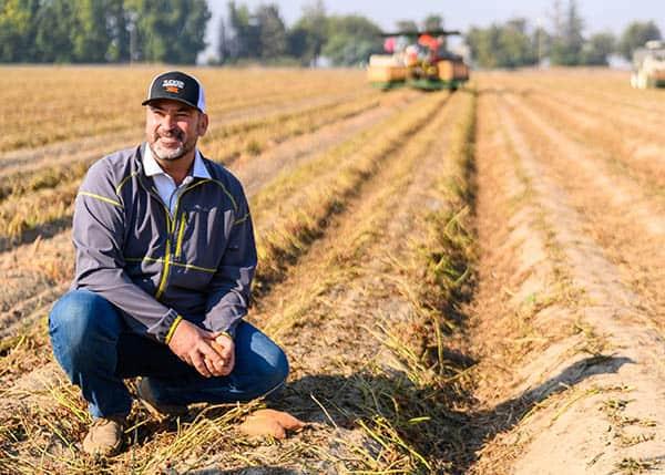 A California sweet potato farmer in the field.
