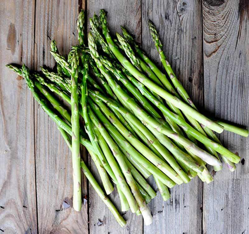 Fresh asparagus ready to be prepped for the grill.