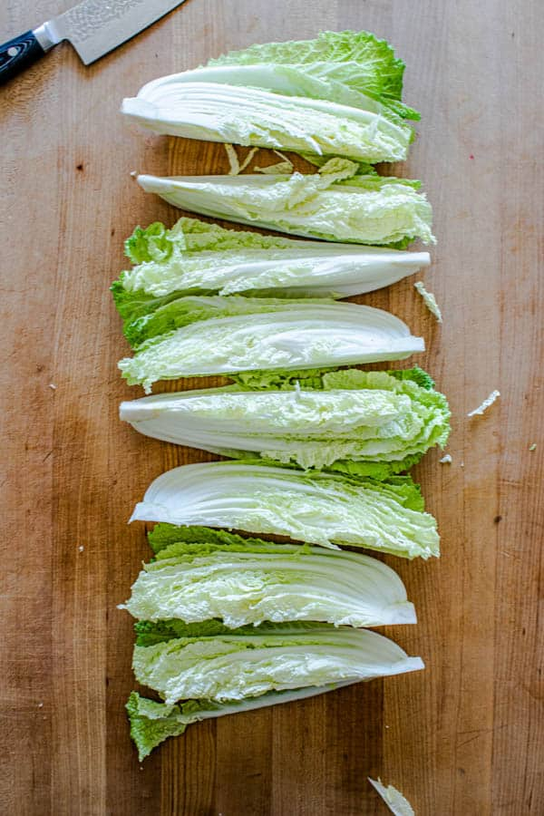 Napa cabbage sliced into 8 wedges for our Melting Napa Cabbage recipe