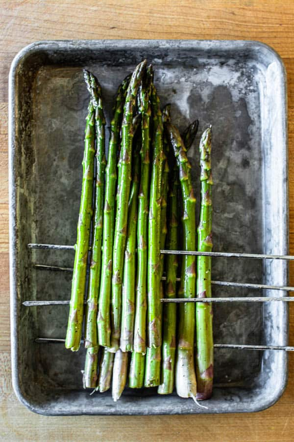 Asparagus prepared for grilling.