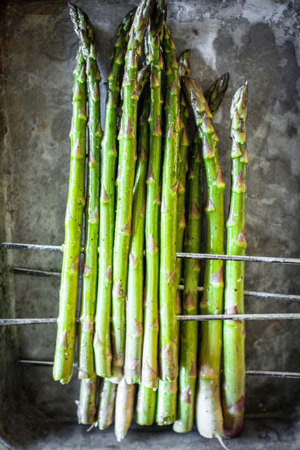 This is how to grill asparagus! Jumbo asparagus spears threaded onto metal skewers for grilling.