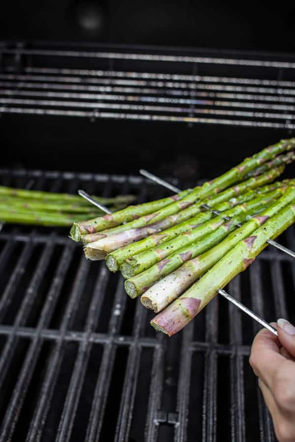 Asparagus rafts being placed on the grill. This is how to grill asparagus!