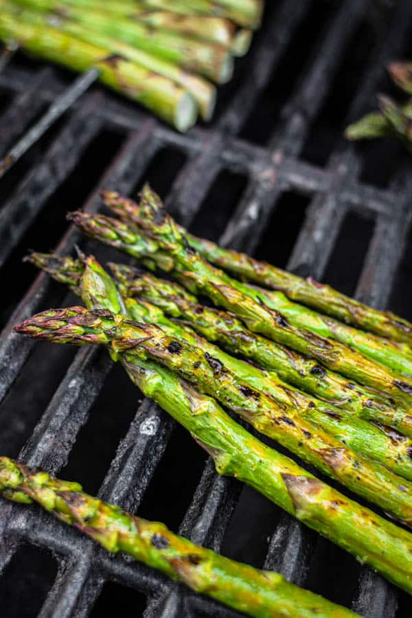 Grilled asparagus rafts ready to come off of the grill.
