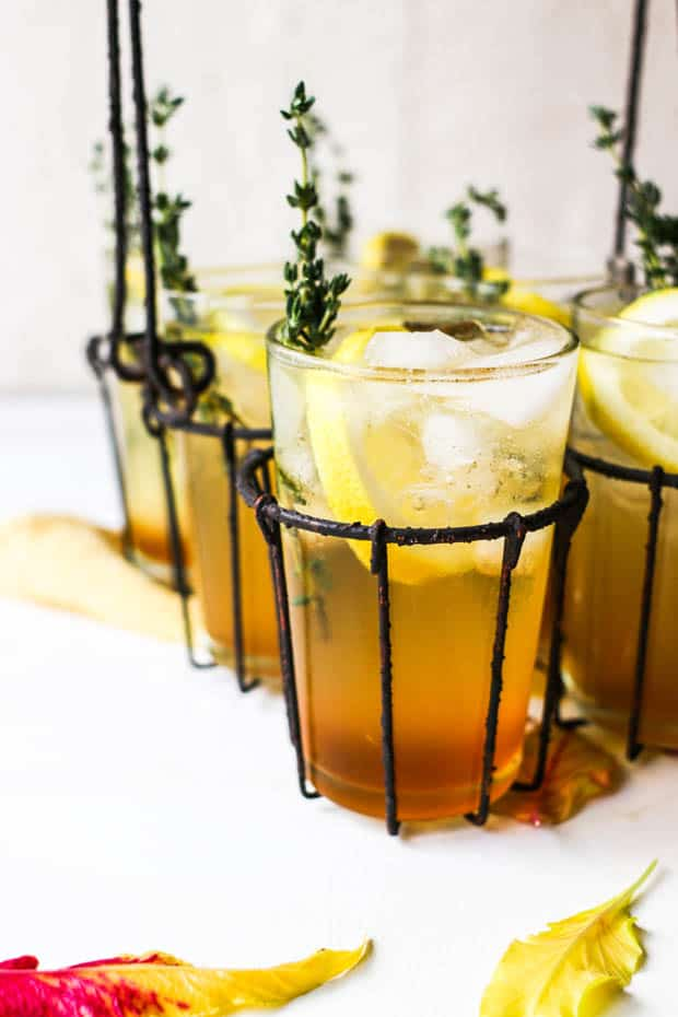 This is how to use honey! Make a honey sweetened cocktail in a glass with slices of lemon and sprigs of thyme.